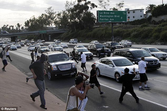 Dangerous: Los Angeles demonstrators began to block traffic on the Interstate 10 freeway while protesting the acquittal of George Zimmerman Sunday Read more: http://www.dailymail.co.uk/news/article-2362973/Protests-erupt-coast-coast-George-Zimmerman-goes-FREE-Second-day-demonstrations-planned-night-anger.html#ixzz2ZBMWwtmQ