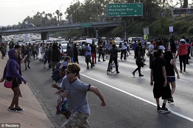 Blocked: With emotions high and traffic stopped, tensions rose as protestors blocked the Los Angeles freeway Read more: http://www.dailymail.co.uk/news/article-2362973/Protests-erupt-coast-coast-George-Zimmerman-goes-FREE-Second-day-demonstrations-planned-night-anger.html#ixzz2ZBMyeW8J